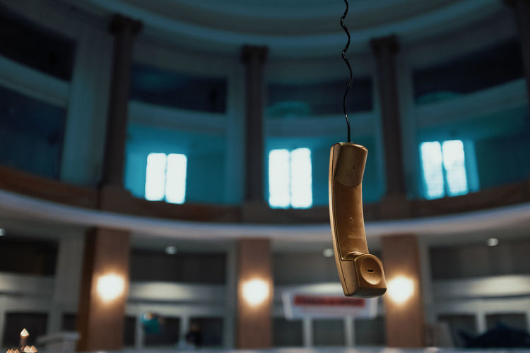 LAST CALL Telephone Line Telephone Focus On Foreground Hanging Illuminated No People Lighting Equipment Close-up Technology Indoors  Electricity  Low Angle View Architecture Selective Focus Built Structure Night Ceiling Communication Music Metal Connection Light Electric Lamp My Best Photo