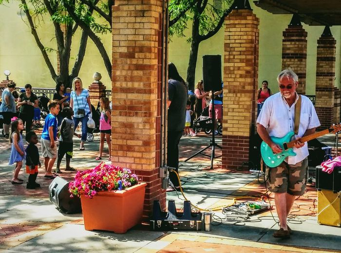 Real People Full Length Day Building Exterior Outdoors Guitar Hero Summer ☀ Fun Irwin Collection EyeEm Gallery EyeEm Best Shots Farmers Market Band Photography Music Photography  Electric Guitar Architecture Musical Instrument Musician Leisure Activity Community Lifestyles Enjoyment