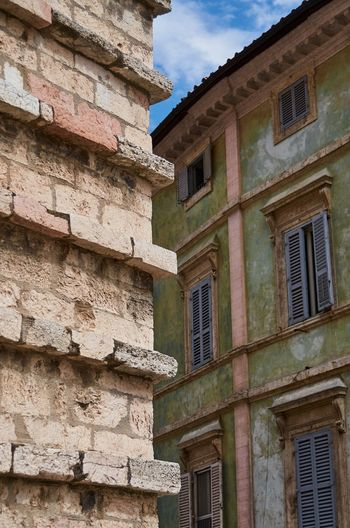 Architectural details in Perugia, Italy Italy Perugia Umbria Architecture Wall Brick Built Structure Building Building Exterior Detail Textures And Surfaces Outdoors No People Sky History Historical Building Façade Weathered Windows Shutters