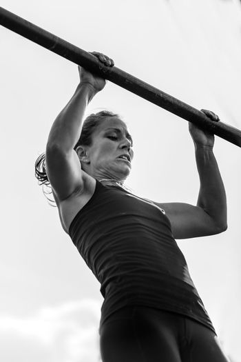 Female Doing Pull Ups On Competition Fitness Cross Training Cross Fit Training Workout Athlete Muscular Competitive Sport Active Exercising Exercise Equipment Black White Black And White Lifestyle Woman Young Girl Attractive Outdoors Pull Ups Sky Day
