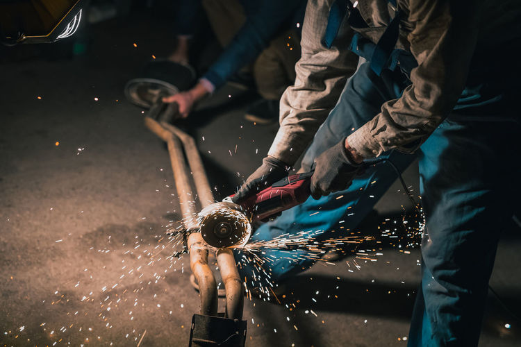 People working on street in city at night