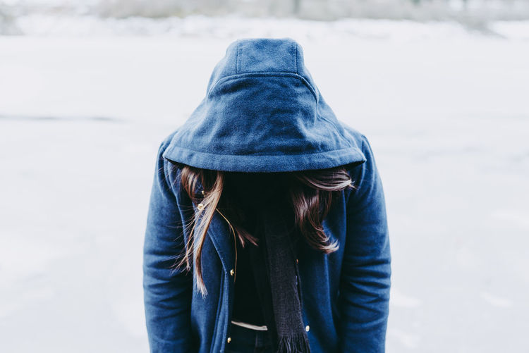 Humbly and mysterious Beautiful Blue Coat Cold Temperature Day Detail EyeEm Best Edits EyeEm Gallery EyeEmBestPics Hair Hiding Hood Hood - Clothing Hoodie Lifestyles Looking Down Mysterious One Person Outdoors People Portrait Real People Winter Young Adult Young Women