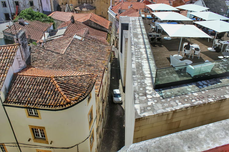 High angle view of swimming pool by buildings in town