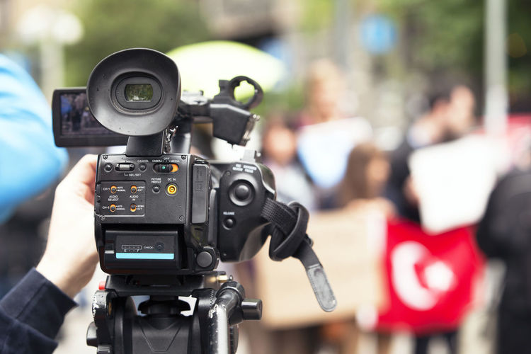 Filming street protest using video camera Camera Man CameraMan Event Press Protest Street Protest Unrecognizable People Broadcasting Journalism Camera Operator Covering The Event Demonstration Filming Footage  Holding Human Hand Media News Outdoors People Protesters Protesting Street Tv Broadcasting Video Camera