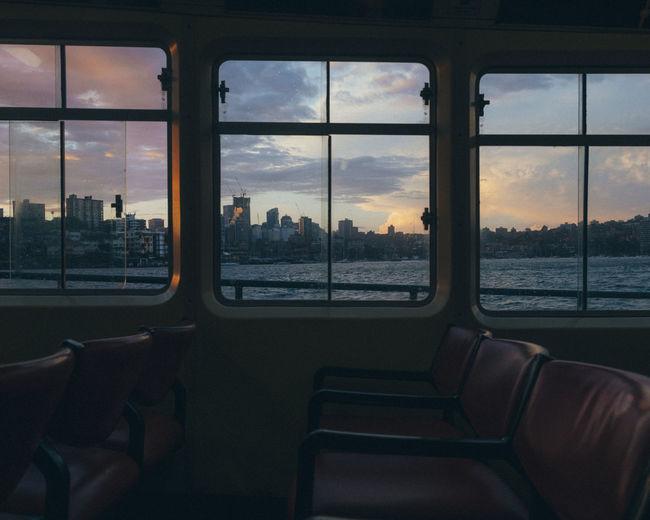 Buildings in city seen through ferry window