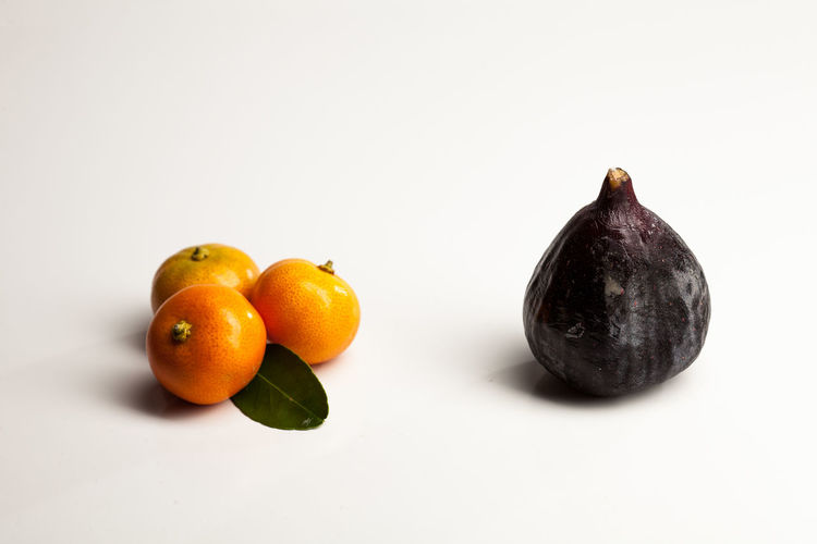 Apple - Fruit Citrus Fruit Close-up Copy Space Cut Out Food Food And Drink Freshness Fruit Group Of Objects Healthy Eating Indoors  No People Orange Orange - Fruit Orange Color Ripe Still Life Studio Shot Wellbeing White Background
