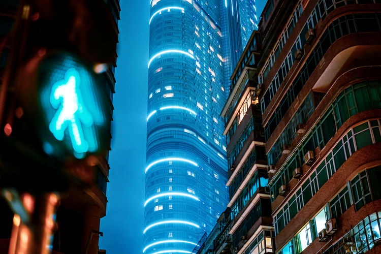 Low angle view of illuminated modern buildings at night
