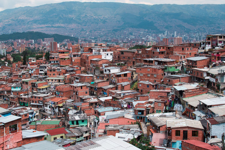 Medellin Colombia and the famous Comuna 13 Architecture Building Exterior Built Structure Building City Residential District Day Outdoors Roof Crowd Crowded House High Angle View Town Community Mountain TOWNSCAPE Human Settlement Nature Cityscape Roof Tile Comuna 13 Comuna Colombia Slums Ghetto South America Streetphotography Art Grafitti Tele Cable