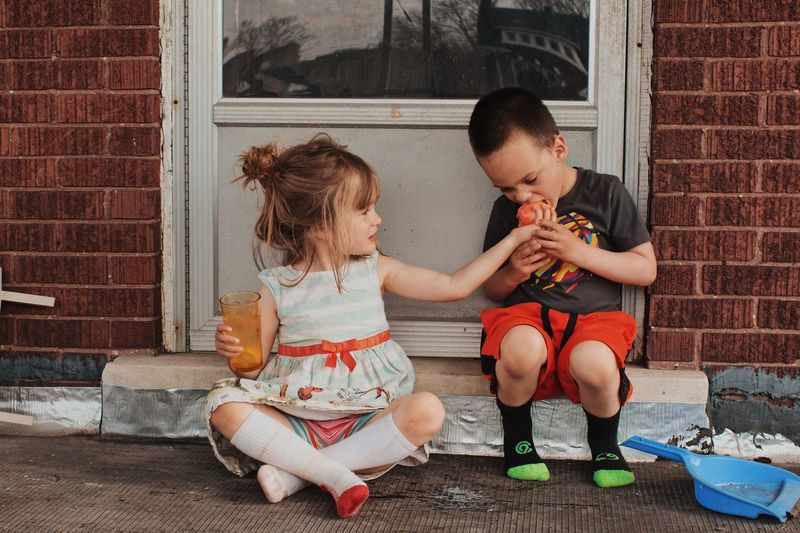 Twins Kids Being Kids Sharing  Apple Children Only Brick Brick Wall Siblings Little Boy Little Girl Lifestyle Photography Twins Childhood Child Two People Family Togetherness Sitting Full Length Bonding People Love