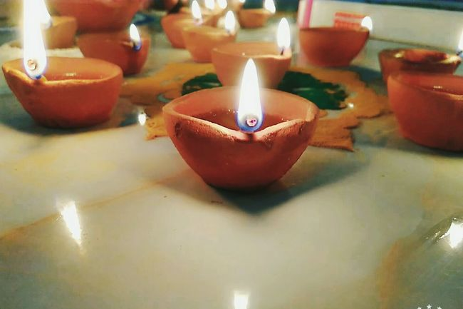Burning Heat - Temperature Flame Candle Close-up Focus On Foreground No People Indoors  Cultures Diya - Oil Lamp Diwali Tea Light Oil Lamp Day Eyeemedits Android Photography Indoors  Lights Light And Shadow Festival Of Lights Indian Culture  in India