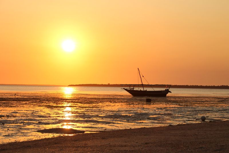 Sunset Sea Sun Water Beauty In Nature Horizon Over Water Tranquil Scene Orange Color Sky Nature Nautical Vessel Scenics Tranquility Outdoors Transportation Clear Sky No People Beach Day Zanzibar Zanzibar_Tanzania Tanzania