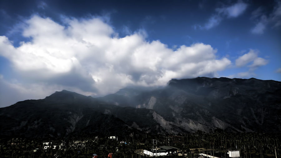 Beauty In Nature Cloud - Sky Day Dramatic Sky Environment Landscape Mountain Mountain Peak Mountain Range Nature No People Outdoors Scenics Sky Storm Cloud