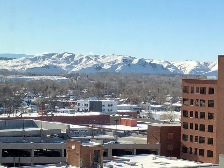 View from my office. Montana The Week on EyeEm Nice View Sunny Cold Temperature Urban Winter Urban Background Backgrounds City Life City Season  Winter Snow Snowy Mountains Billings Snow Winter Cold Temperature Mountain House Snowcapped Mountain Weather Building Exterior Architecture Mountain Range Built Structure Beauty In Nature Scenics Cityscape