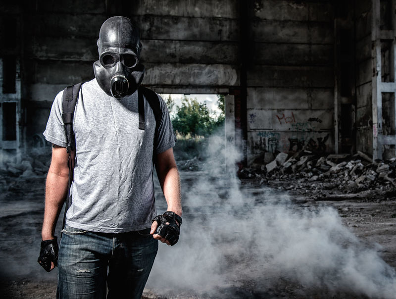 Man in a gas mask Gas Radioactive Revolution Smoke Adult Chemical Danger Dangerous Disaster Fumes Gas Mask Hazard Male Men Only Men Opposition People Pollution Protective Mask Radiation Stalker Terrorism Terrorist Toxic War