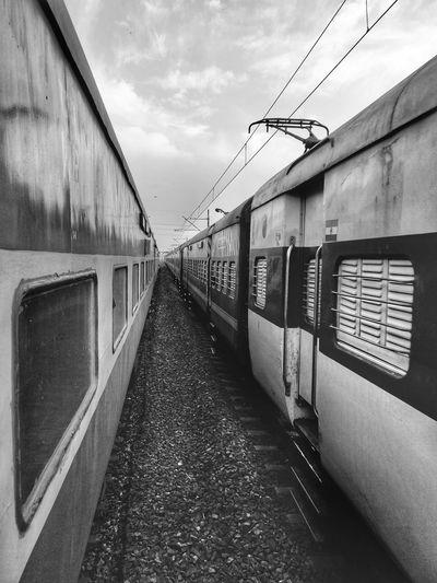 Train at railroad station platform against sky