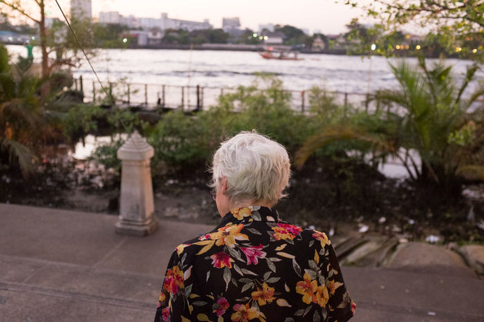 Building Exterior Carrying Casual Clothing City City Life Day Elderly Flower Focus On Foreground Headshot In Front Of Old Outdoors Person Plant Rear View Tourism Travel Destinations Vacations Water Woman