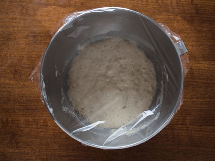 Close up shot of fermenting and bubbling yeast starter, biga or poolish made of strong wheat or bread flour, yeast and water which is a pre-dough used for pizza, bread, panettone or all kind of yeast risen dough based baked goods Biga Fermenting Food And Drink Baking Bowl Bread Dough Bubbling Dough Fermentation Flour Food High Angle View Kitchen Kitchen Utensils Mixing Bowl No People Poolish Raising Rising Yeast  Yeast Dough