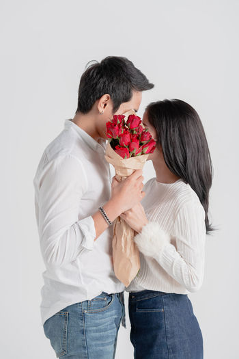 couple with bouquet of flowers,love and relationship and dating concept Love Couple - Relationship Kiss Valentine's Day  Bouquet Flower Rose - Flower Togetherness Holding Embracing Lifestyles Anniversary Celebration Happiness Honeymoon Human Hand Fun