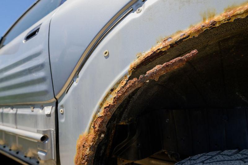Close-up of rusty mudguard of car