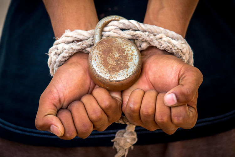 Freedom Rope Freedoom  Hand Handcuffs  Hands Cupped Holding Human Hand Lock Midsection One Person Rope Slave Strength Tied The Photojournalist - 2018 EyeEm Awards