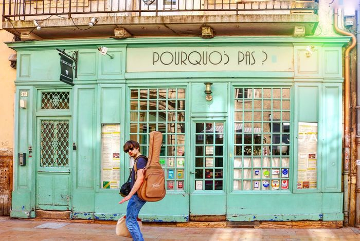 Pourquoi Pas Vintage Shop Travel Architecture One Person Real People Built Structure Building Exterior Lifestyles Entrance Day Door Full Length Leisure Activity Text Casual Clothing Adult Standing City Outdoors Adventures In The City
