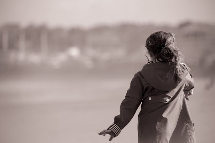 Sophia ❤️️ Real People Leisure Activity One Person Lifestyles Rear View Focus On Foreground Outdoors Walking Standing Nature Day Beach Sea Sky People EyeEm Gallery EyeEm Best Shots EyeEm Kids Being Kids Girl Sepia EyeEm Best Shots - Black + White