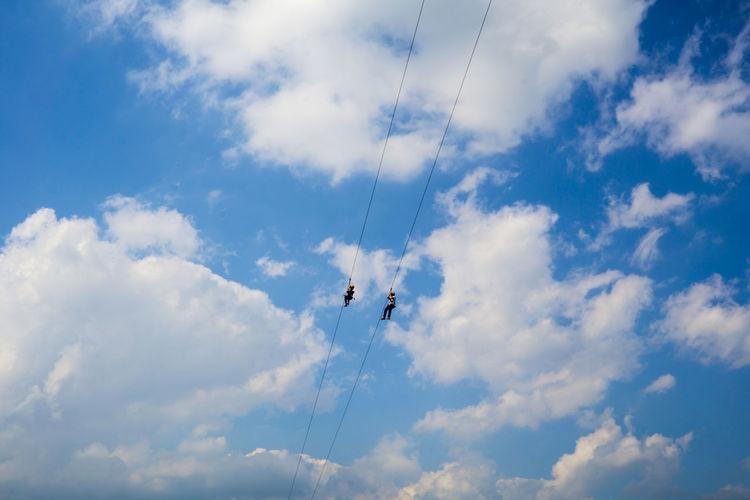Low Angle View Of People Ziplining