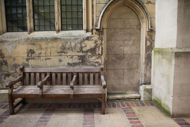 Wooden Bench Outside Old House