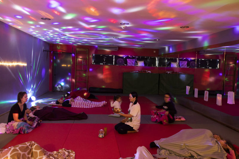 Portugal; Aula de Yoga Yogagirl Group Of People Real People Women Men Illuminated Indoors  Sitting Lifestyles Arts Culture And Entertainment Lighting Equipment Leisure Activity Adult Full Length People Night Flooring Crowd Event Togetherness Light Nightlife