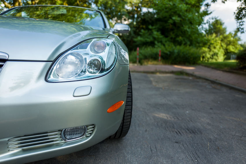 Lexus SC 430 SC430 Car City Close-up Day Focus On Foreground Headlight Land Vehicle Mode Of Transportation Motor Vehicle Nature No People Outdoors Plant Retro Styled Road Silver Colored Stationary Street Transportation Vehicle Light Vintage Car
