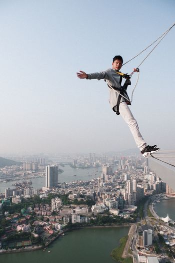 Adrenaline Rooftop HongKong Macau Bunjee Jumping Adrenaline Mid-air Full Length Architecture City Built Structure One Person Building Exterior Cityscape Sky Nature Extreme Sports Sport Human Arm Flying Motion Outdoors Joy Limb