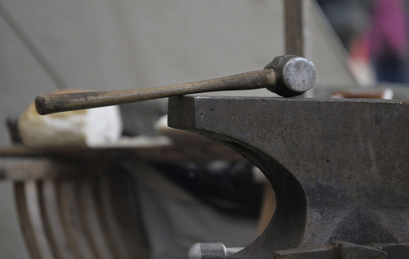 A heavy hammer placed on the edge of a heavy anvil. Blacksmith  Industrial Skill  Anvil Close-up Day Focus On Foreground Hammer Metal Metalworking No People Old Rusty Selective Focus Tools Trade Work Tool