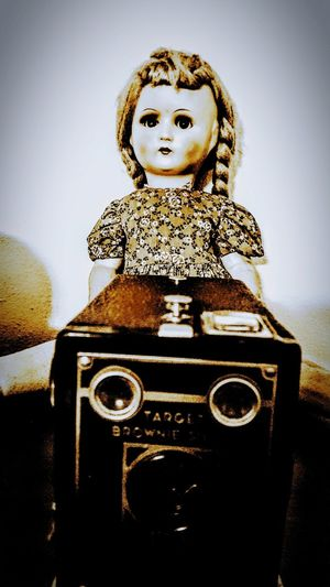 Antique Doll and Old Brownie Camera Shadows & Lights History Ghost Antique Antique Doll Camera Eerie Close-up Day Outdoors Sky