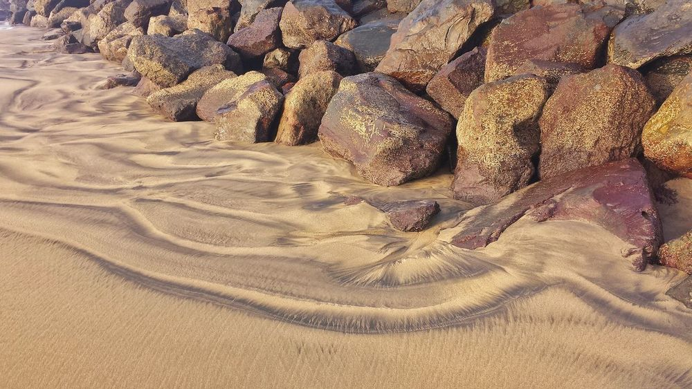 EyeEmNewHere Waves Sand Stones On The Beach Traces In The Sand Gold Near The Sea Nature Beauty In Nature The Week On EyeEm