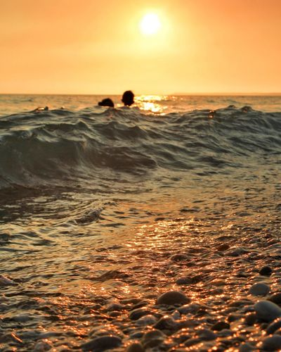 Sunset Sea Beach Orange Color Horizon Over Water Nature Silhouette Wave Human Body Part Scenics Tranquil Scene Sand People Full Length The Week On EyeEm Shadows Travel Destinations Tranquility Sicily Mediterranean  Seascape Photography Watersurface Travel Reflection Portrait Perspectives On Nature
