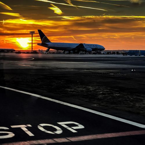 Sunrise at the Airport Travel Photography Travel Plane Sky Sunrise_Collection Sunrise_sunsets_aroundworld Sunrise Airport Frankfurt Am Main Sunset Road No People Transportation Mode Of Transportation Air Vehicle Airport Runway Airplane Cloud - Sky Nature Sign Travel Dusk Dramatic Sky Architecture Outdoors Scenics - Nature Sea