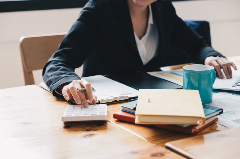 Midsection of woman working at office