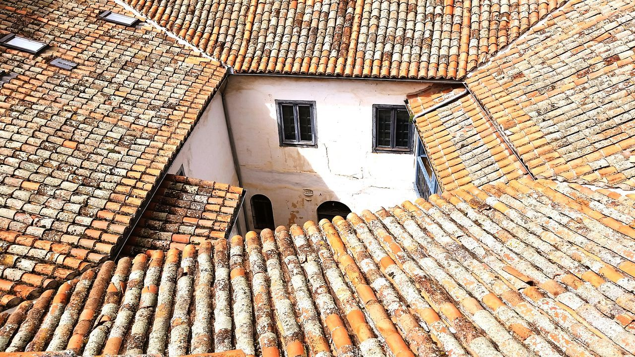 architecture, building exterior, built structure, roof tile, no people, roof, day, outdoors, low angle view