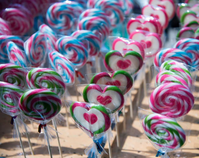 Close-up of colorful lollipops arranged at market