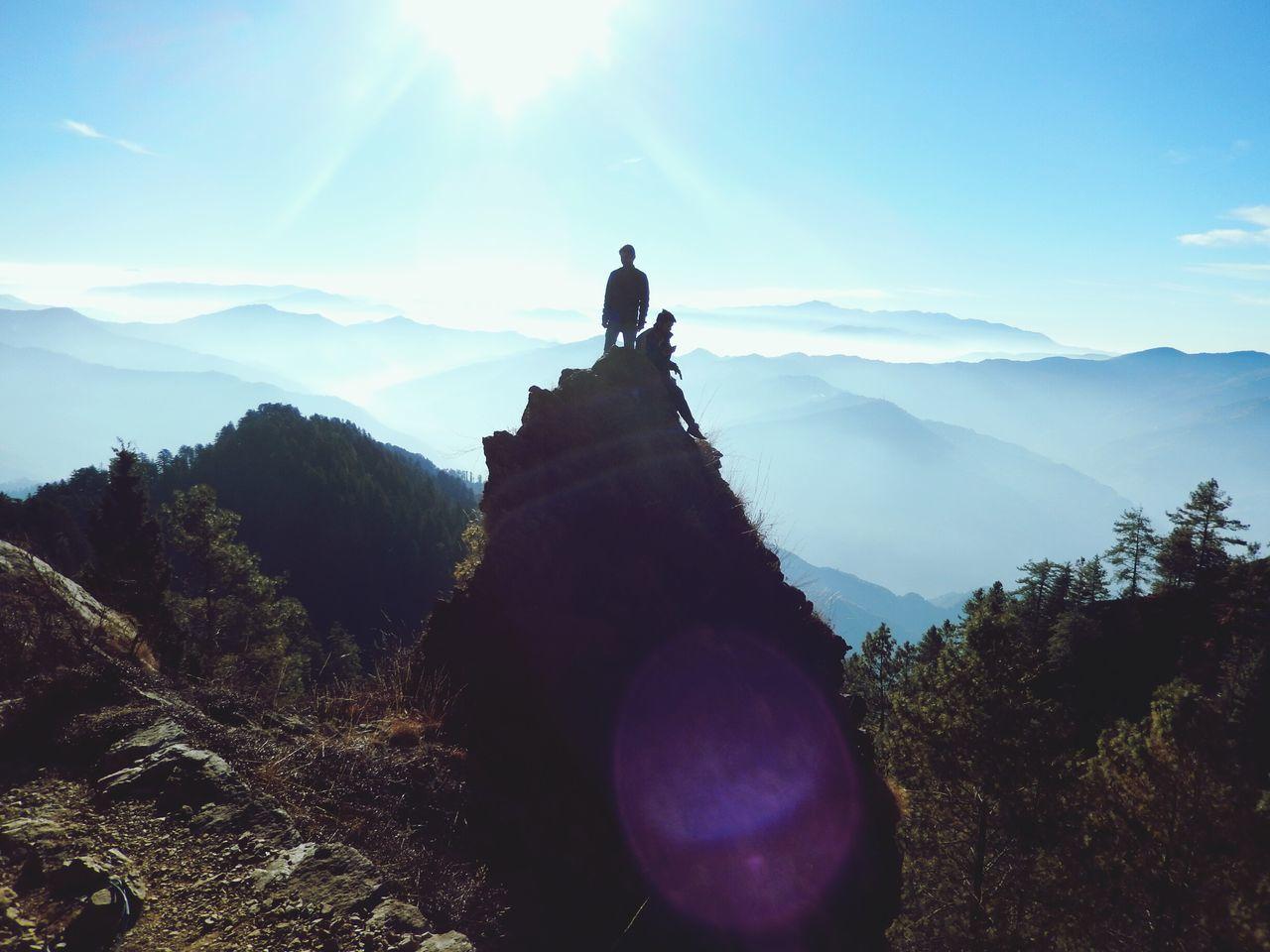 SUN SHINING THROUGH MOUNTAIN