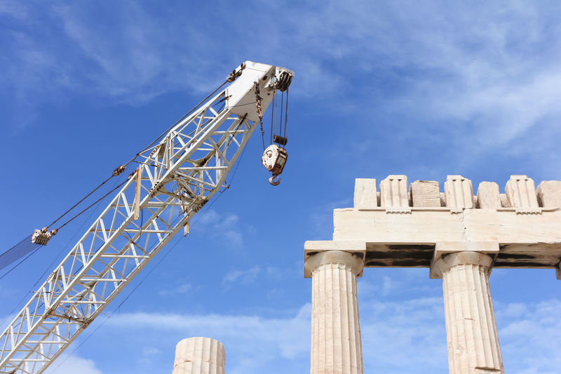 Temple Repair Parthenon Acropolis Ancient Civilization Architectural Column Architecture Athens Blue Built Structure Cloud - Sky Construction Industry Construction Site Crane - Construction Machinery Day History Industry Low Angle View Machinery Metal Nature No People Outdoors Ruined Sky Tall - High The Past