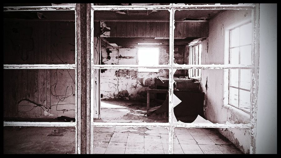 Looking Inside Through The Window Broken Window Broken Glass Abandoned What Remains  ExploreEverything Light And Shadow Empty Room Beauty In Decay Lost Places Forgotten Places