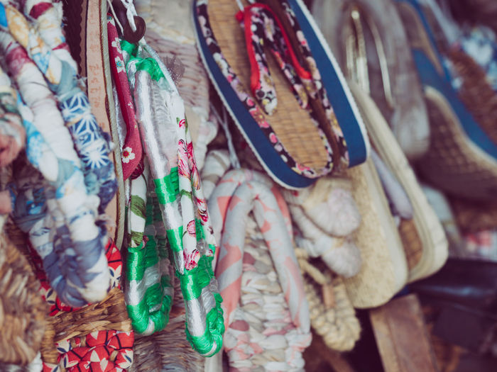 Close-up of colorful flip-flops for sale in market