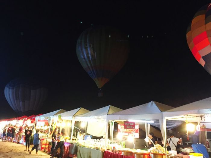 Large Group Of People Men Real People Women Leisure Activity Night Lifestyles Crowd Illuminated Outdoors City Hot Air Balloon Ballooning Festival Sky Adult People Adults Only