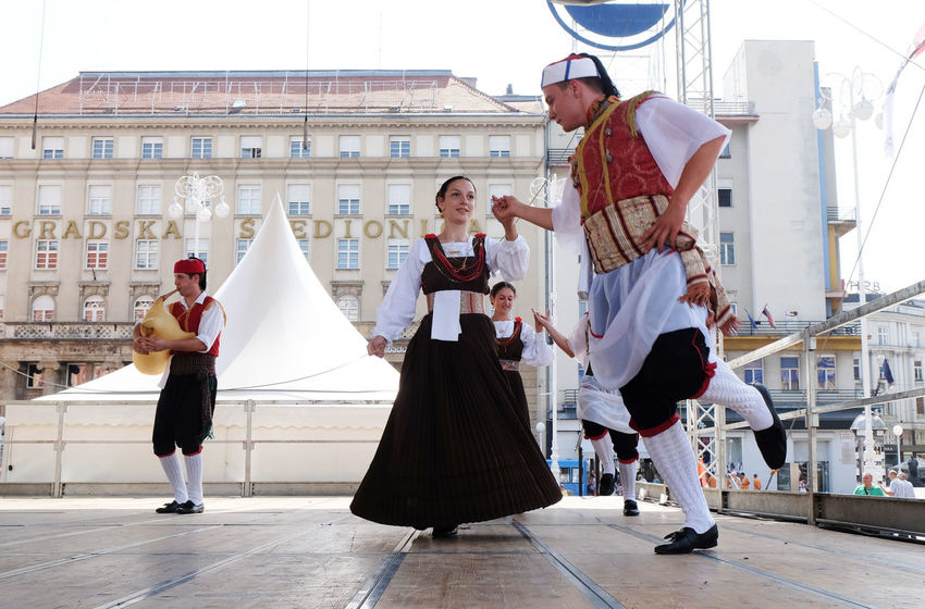 Members of folk group Kumpanija from Blato, island of Korcula, Croatia during the 50th International Folklore Festival in center of Zagreb, Croatia on July 23, 2016 Blato Celebration Costume Croatia Culture Dance Entertainment Event Festival Folk Folklore Heritage Historic Korčula Music Participant Perform Show Style Tradition Zagreb