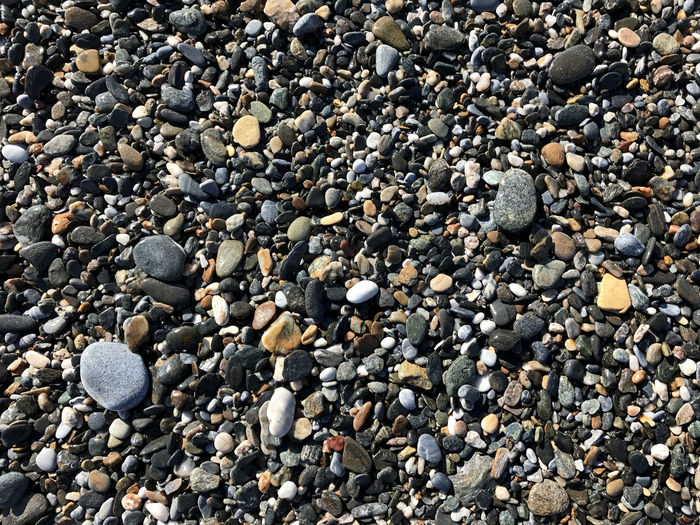 Beach stones at surf Abundance Beach Beauty In Nature Close-up Day Full Frame Large Group Of Objects Nature No People Outdoors Pebble Pebble Beach Shore Stones