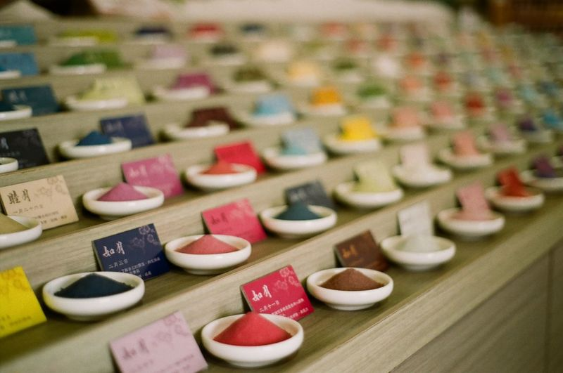 Colorful spices in bowls arranged with price tags at market