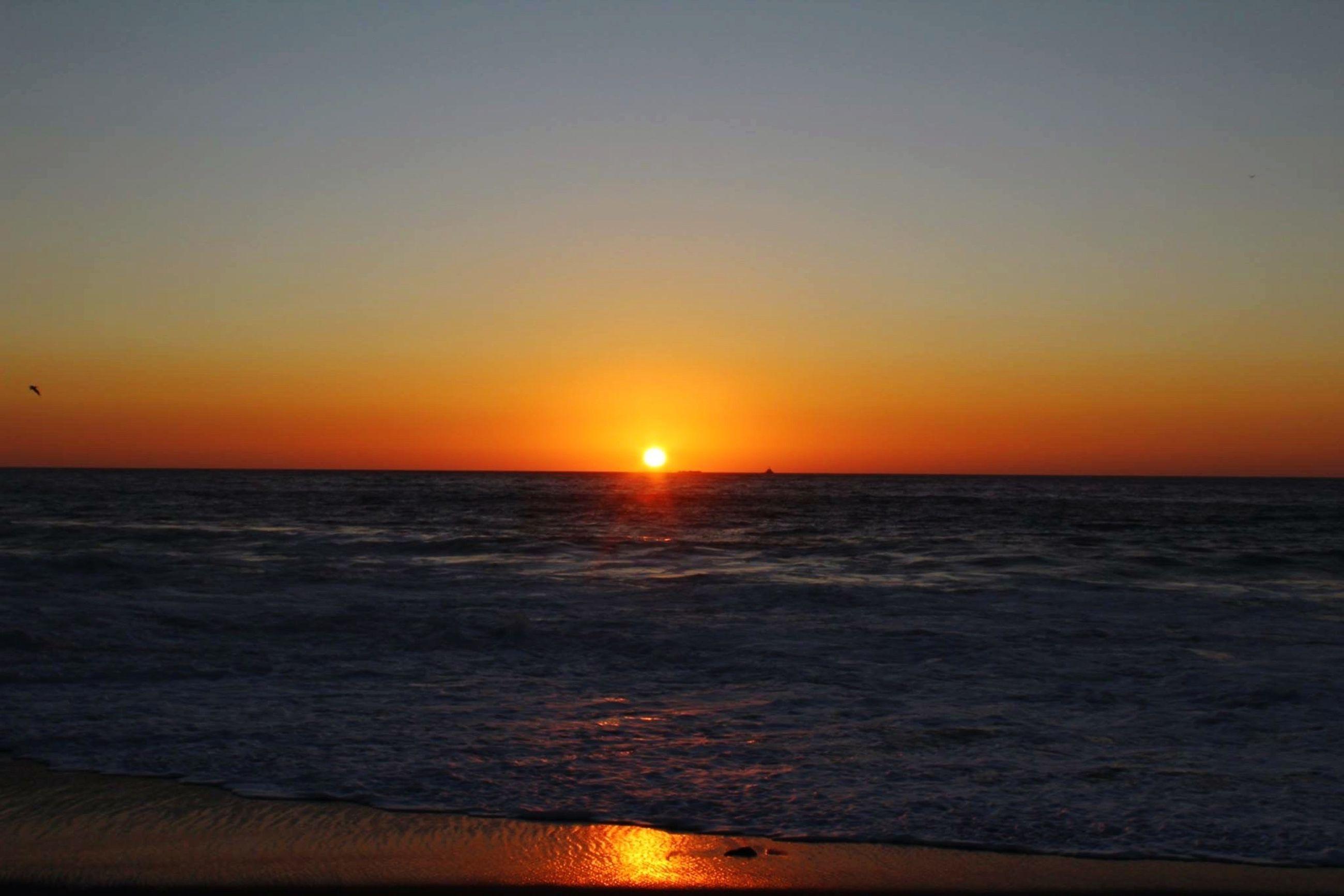 sunset, sea, sun, horizon over water, water, orange color, scenics, tranquil scene, beauty in nature, tranquility, idyllic, nature, sunlight, sky, rippled, seascape, outdoors, remote, no people, ocean, non-urban scene, majestic, sunbeam