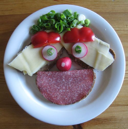 High Angle View Of Anthropomorphic Face Made From Meat And Vegetables