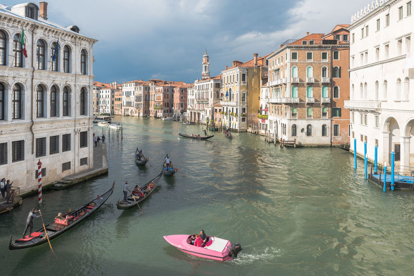 Heavy traffic on Canal Grande Architecture Boats Buildings City City Life Cityscape Clouds And Sky Cruisin' Gondola Pink Sea Sky Transportation Venice Water Art Is Everywhere Break The Mold The Street Photographer - 2017 EyeEm Awards BYOPaper! Live For The Story Neon Life Second Acts